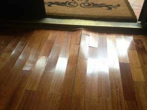 Wood Floor Drying - example of cupped floorboards.